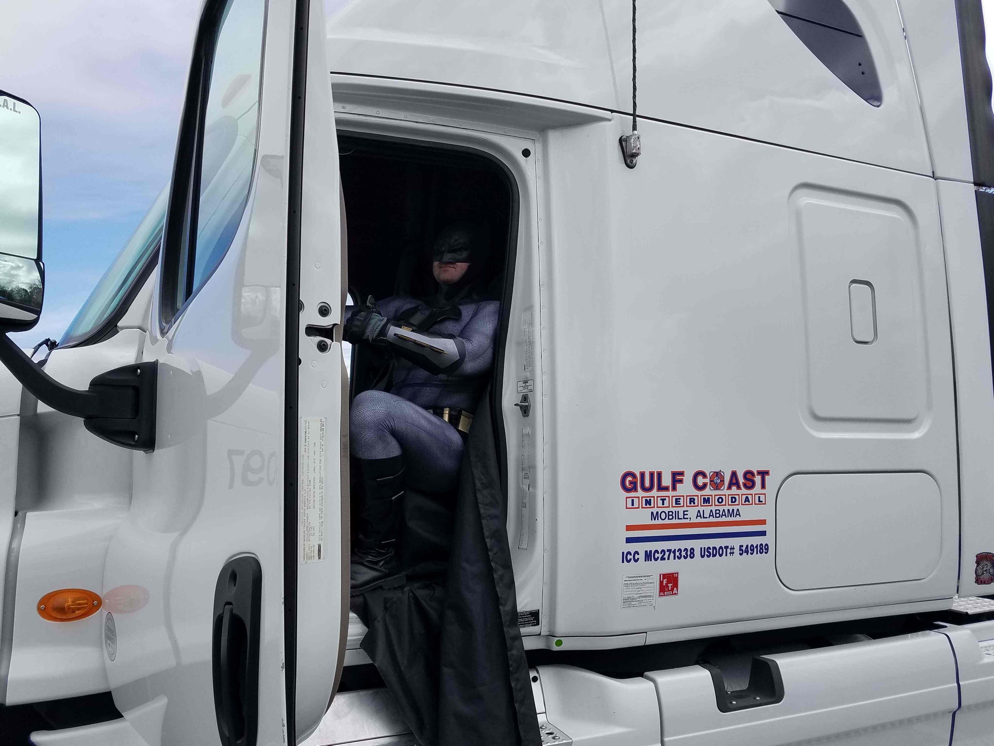 Batman driving a Gulf Coast Intermodal Truck